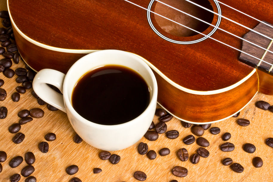 Coffee  and Ukulele on wood background