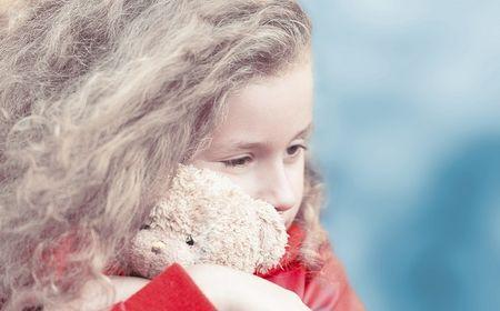 Beautiful little girl with teddy bear.