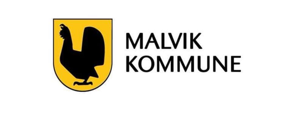 Bilde av kommunevåpen på hvit bakgrunn