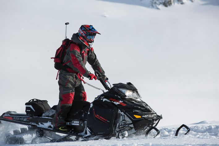 person-riding-on-snowmobile-804568