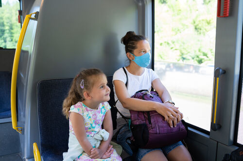 41214049-woman-on-bus-wearing-face-mask
