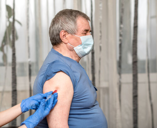 45795313-doctor-vaccinating-male-patient-in-clinic-closeup