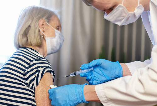 45322551-85-year-old-woman-receives-the-covid-19-vaccine-from-a (1)