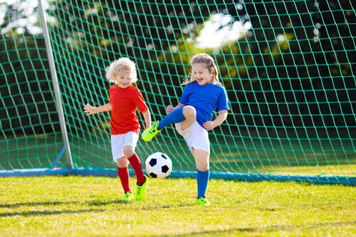 37005260-kids-play-football-child-at-soccer-field
