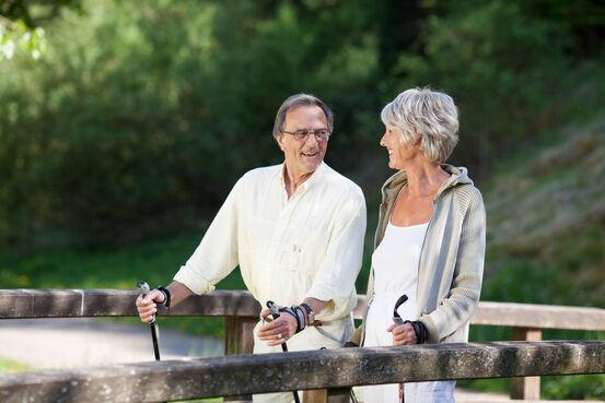 7605843-senior-couple-doing-a-nordic-walk-on-bridge